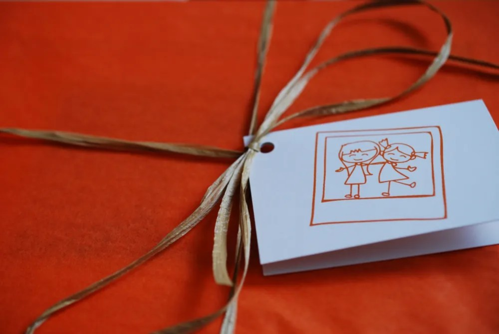Orange tissue paper and a personalized note. Photo: Jenny Bristol