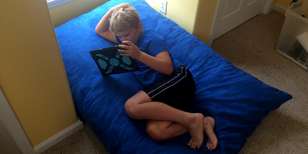 Lounging on the Sumo Omni Plus bean bag chair
