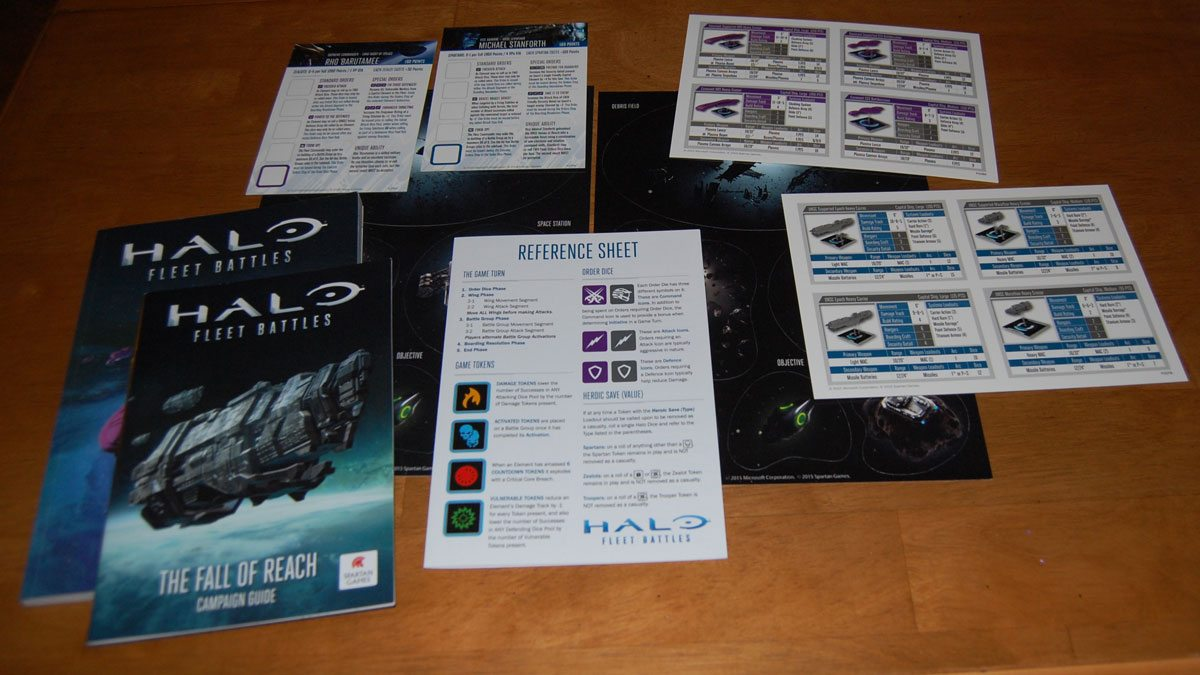 'Halo: Fleet Battles' rule book, campaign guide, terrain, and reference sheets. Photo by Rob Huddleston.
