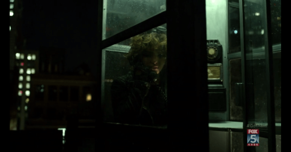 A youngster using a phone booth. The fakest Gotham scene ever. (Image via FOX)