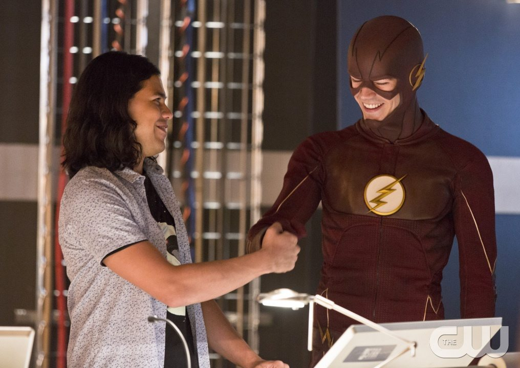 """The Flash -- """"Family of Rogues"""" -- Image FLA203a_0017b.jpg -- Pictured (L-R): Carlos Valdes as Cisco Ramon and Grant Gustin as The Flash -- Photo: Jeff Weddell/The CW -- �© 2015 The CW Network, LLC. All rights reserved."""