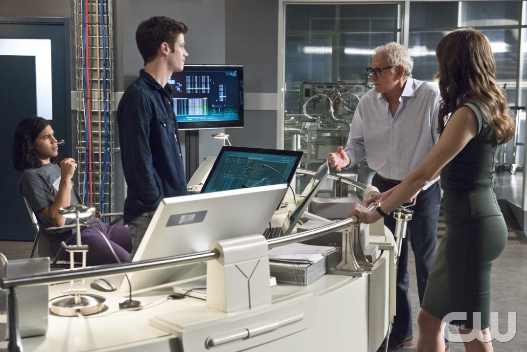 """The Flash -- """"The Fury of Firestorm"""" -- Image FLA204A_0074b -- Pictured (L-R): Carlos Valdes as Cisco Ramon, Grant Gustin as Barry Allen, Victor Garber as Professor Stein and Danielle Panabaker as Caitlin Snow -- Photo: Cate Cameron /The CW -- �© 2015 The CW Network, LLC. All rights reserved."""