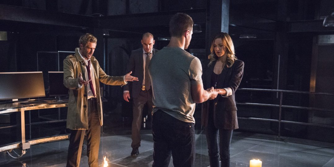 "Arrow -- ""Haunted"" -- Image AR404B_0027b.jpg -- Pictured (L-R) Matt Ryan as Constantine, Paul Blackthorne as Detective Quentin Lance, Stephen Amell as Oliver Queen and Katie Cassidy as Laurel Lance -- Photo: Cate Cameron/ The CW -- �© 2015 The CW Network, LLC. All Rights Reserved."