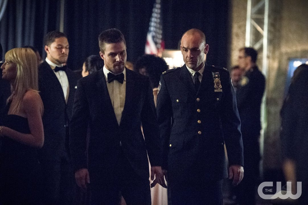 "Arrow -- ""Brotherhood"" -- Image AR407B_106b.jpg -- Pictured (L-R): Stephen Amell as Oliver Queen and Paul Blackthorne as Detective Quentin Lance -- Photo: Cate Cameron/The CW -- �© 2015 The CW Network, LLC. All Rights Reserved."
