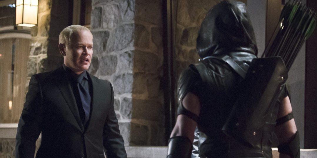 "Arrow -- ""Blood Debts"" -- Image AR410a_0167b.jpg -- Pictured (L-R): Neal McDonough as Damien Darhk and Stephen Amell as The Arrow -- Photo: Katie Yu/ The CW -- �© 2015 The CW Network, LLC. All Rights Reserved."