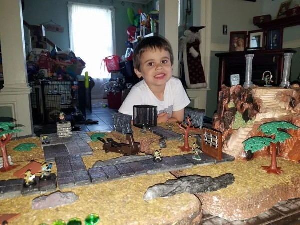 My Son Nicholas enjoying a bit of Goblin gaming with his New Tiles