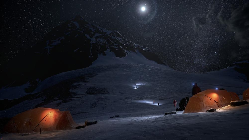 A snow field at night, climbers ascending the mountain in 'Everest VR', their lights illuminating sections of the snow.