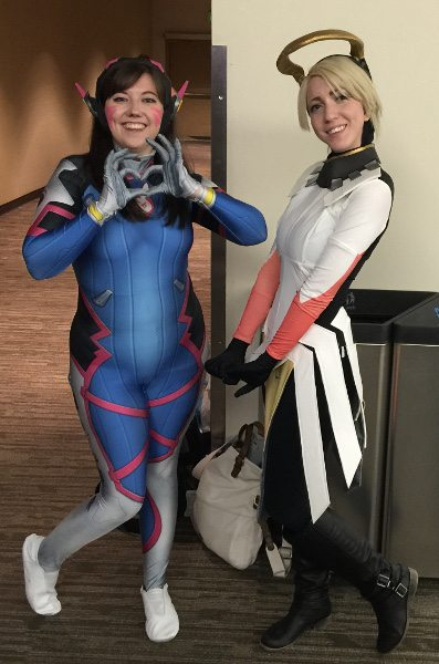 A D.VA and Mercy pose side by side in Overwatch cosplay at PAX West 2016