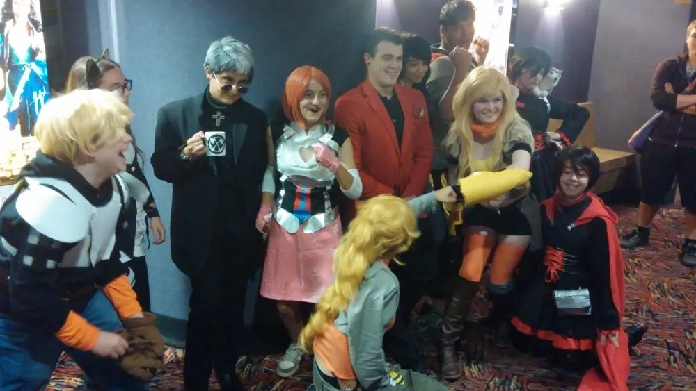 Cosplaying RWBY fans pose for group pics after the show.