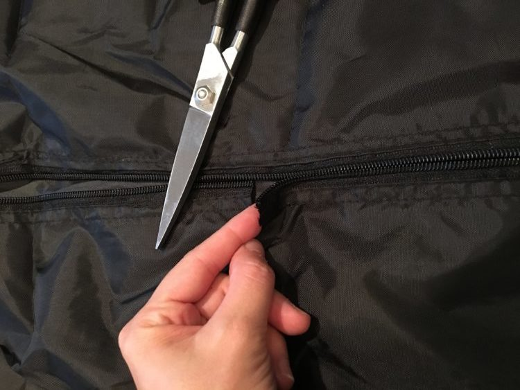 I cut the zipper to make the bags suffocation safe.