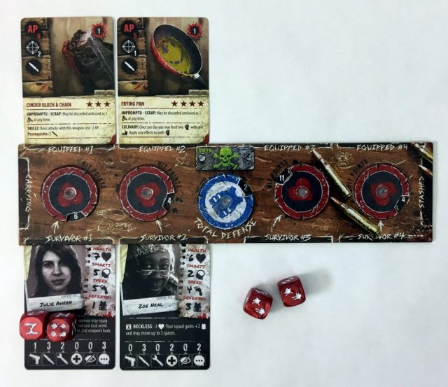 Two survivors in Zpocalypse 2 with dice assigned to Julie Ahern (one Z and one 4) and two other dice nearby.