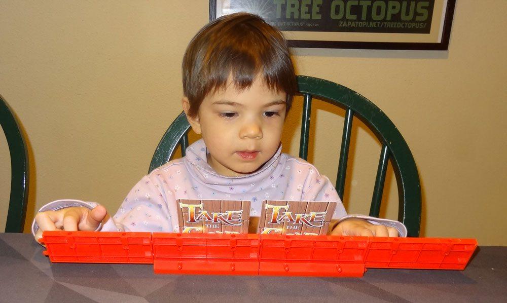 Toddler playing Take the Gold