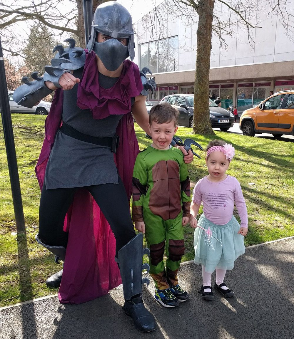 Thrifty Props Family photo as Shredder, Teenage Mutant Ninja Turtle, and princess.