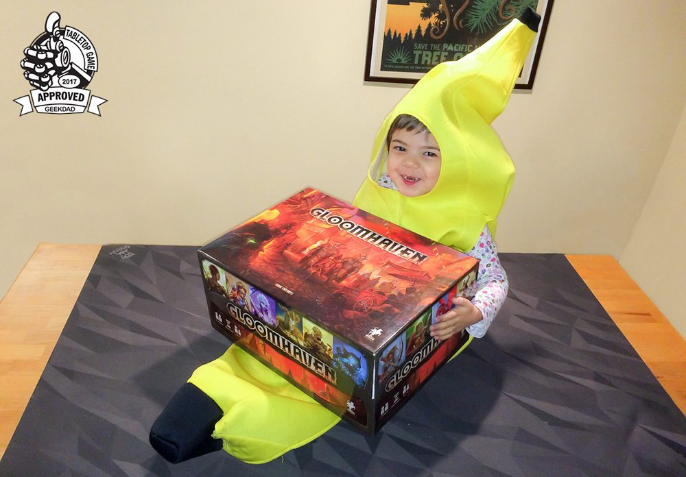 Gloomhaven box with toddler in banana costume