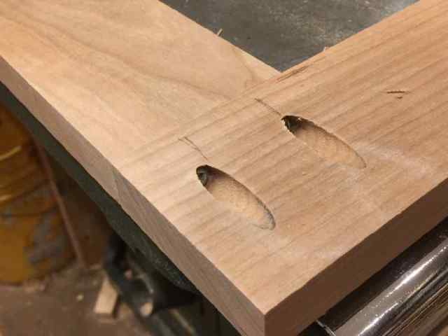 Hidden screws on top frame.