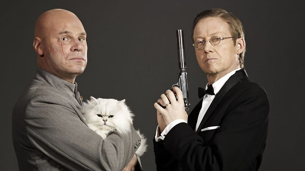 Mark Kermode and Simon Mayo as Blofeld and Bond. Image: (c) BBC