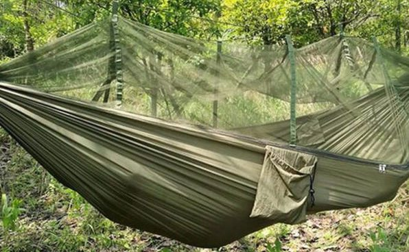 made for sleeping out under the stars this light weight green hammock sports a built in mosquito       geekdad daily deal  military hammock tent   geekdad  rh   geekdad