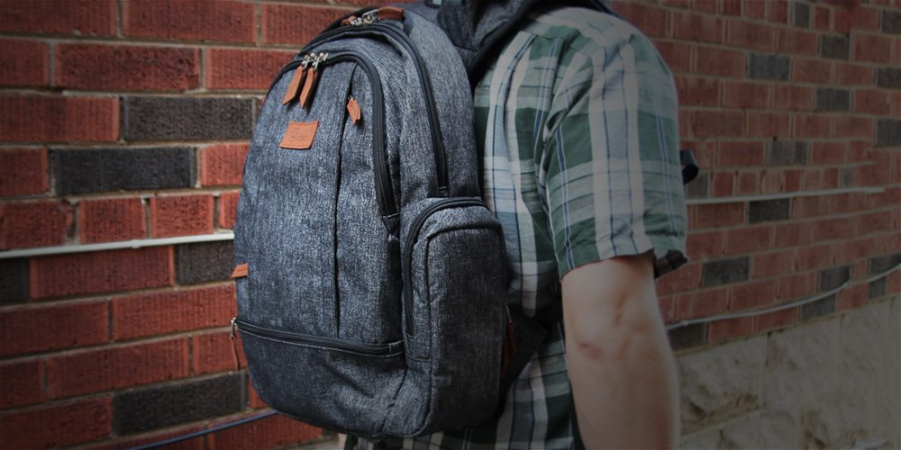 Person standing and wearing a Wolffepack Luna backpack.