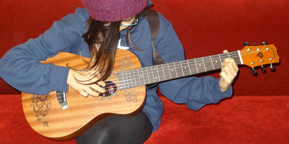 Daughter playing Coco guitar