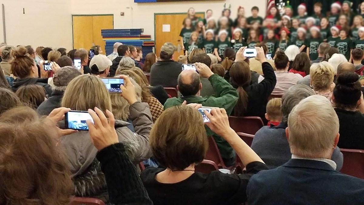 Phones recording a children's christmas concert