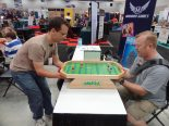 John and Dave try out Weykick, a magnetic soccer game, at the Mayday Games Booth.