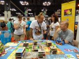 One of our favorites of the weekend: Rampage, from Asmodee Games, lets you tear down a city and eat up meeples by flicking, dropping, and blowing things down.