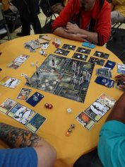 Iello Games had a prototype of Guardians Chronicles, a one-vs-many game of superhero combat.