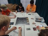 Space Cadets: Dice Duel from Stronghold Games is a real-time space battle between two teams. It's amazing—and also sold out at Gen Con.