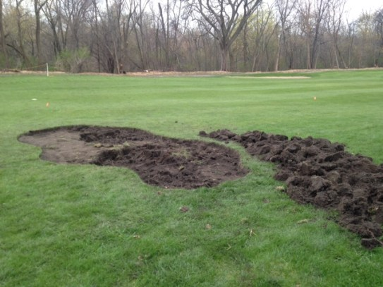 Turf is removed in the new bunker location.