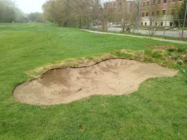 Finished bunker with sand is now in play and growing in. Necessary repairs will be made throughout the season as the grass establishes.