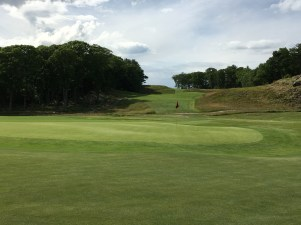 #16 - Back right of the green with the 17th fairway behind
