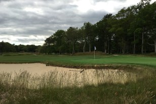 #10 - Par 4 - Bunker extending back right of the green