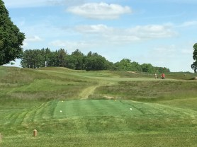 #11 - Par 4 - Tee view to the sloping fairway