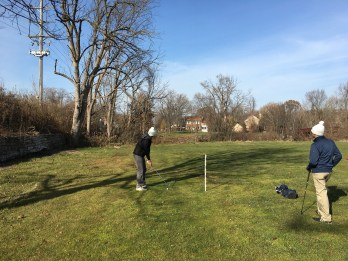Michael playing back over the canal to 15 green.