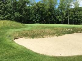 #15 - Par 5 - Short left bunker and mound