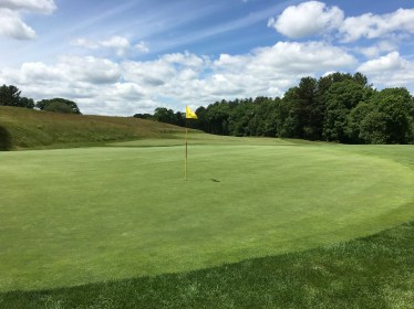 #18 - Par 4 - Green back view of fariway sloping off the hillside