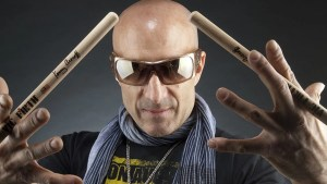 Kenny Aronoff holding his signature Vic Firth drumsticks