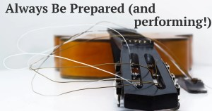 """broken guitar with caption """"Always Be Prepared (and performing)"""""""