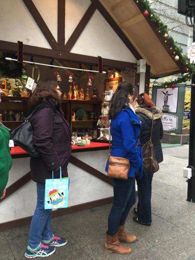 Members checking out a market stall.
