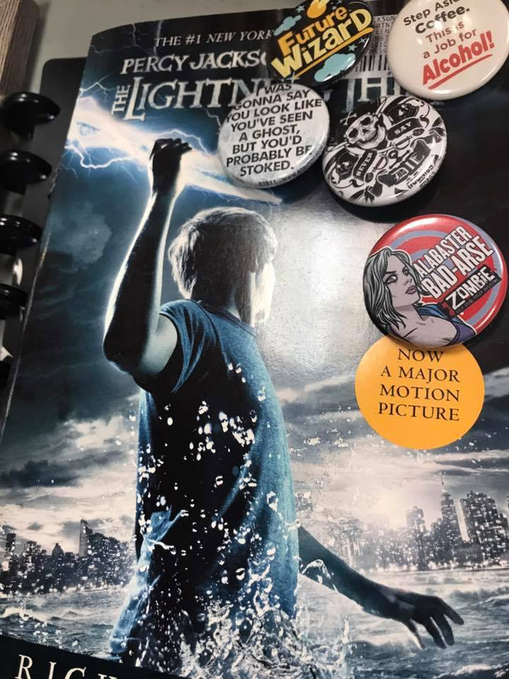The Lightning Thief book covered with pins