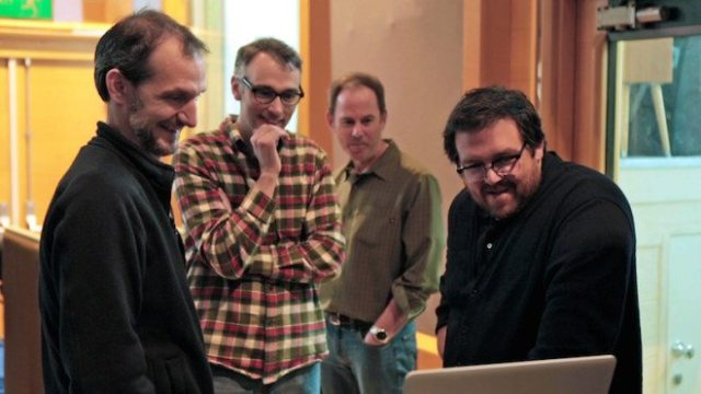 (L to R) Director Anthony Stacchi, Director Graham Annable, Producer David Ichiok and voice talent Nick Frost review a scene during production of LAIKA and Focus Features' family event movie The Boxtrolls, opening nationwide September 26th.