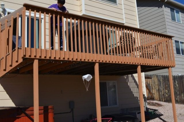 Launching the homemade parachute off the back deck. Photo: Patricia Vollmer.