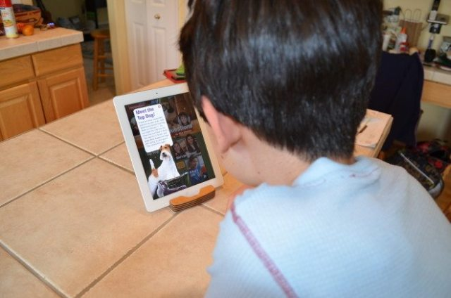 My oldest son reads a sample issue of Time for Kids on our iPad. He enjoyed the photography and we discussed the situation in the Ukraine. Photo: Patricia Vollmer.