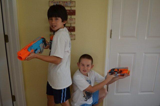 My boys striking a pose with their Nerf Zombie Strike blasters. Photo: Patricia Vollmer.