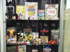 Three shelves of I Spy / Batman display. (Photo used with permission)