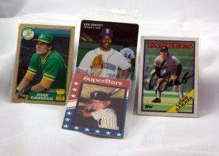 These guys play(ed) baseball. The Jose Canseco card is actually a rookie card (that has been well loved and shared). The guy in front is Tim at age 9.