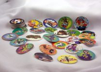 "My hubby kept his Pogs, though he was never ""into"" them. I don't know much about them except that they were banned from our elementary school in the late '80's."