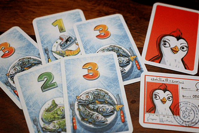 Red's character card and ID with some fish cards, Image: Sophie Brown