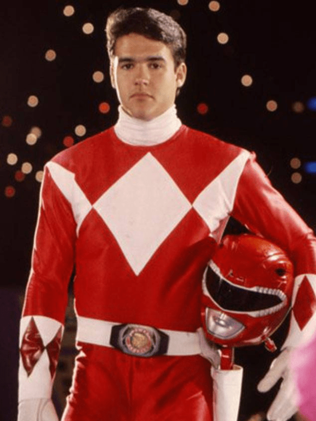 Jason from Mighty Morphin Power Rangers in his suit, holding his helmet