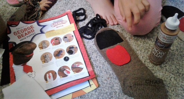 Directions and pieces of felt laid out on a sock